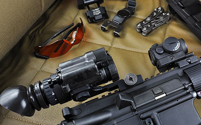 Armasight PVS-14 night vision monocular shown mounted on assault rifle
